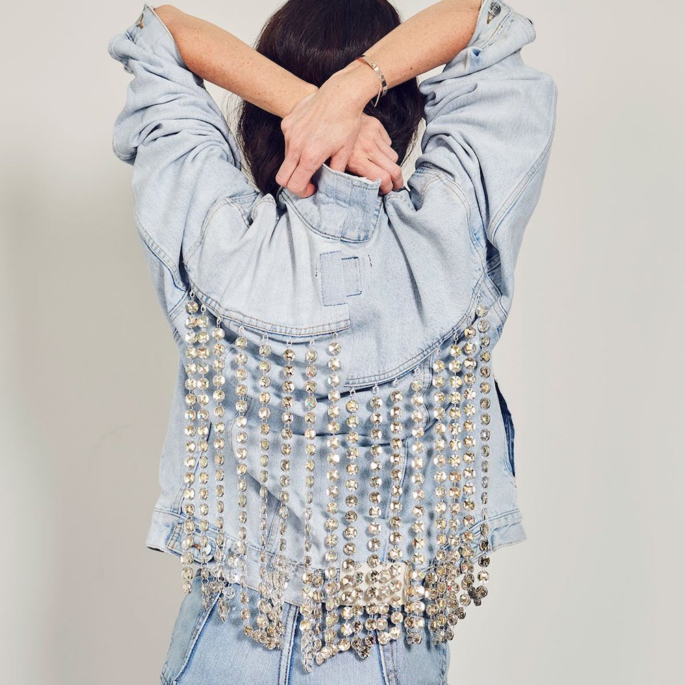 E.L.V. Denim is teaming up with Swarovski to create an exclusive seven-piece capsule collection made from 100 percent upcycled denim and upcycled crystals.
