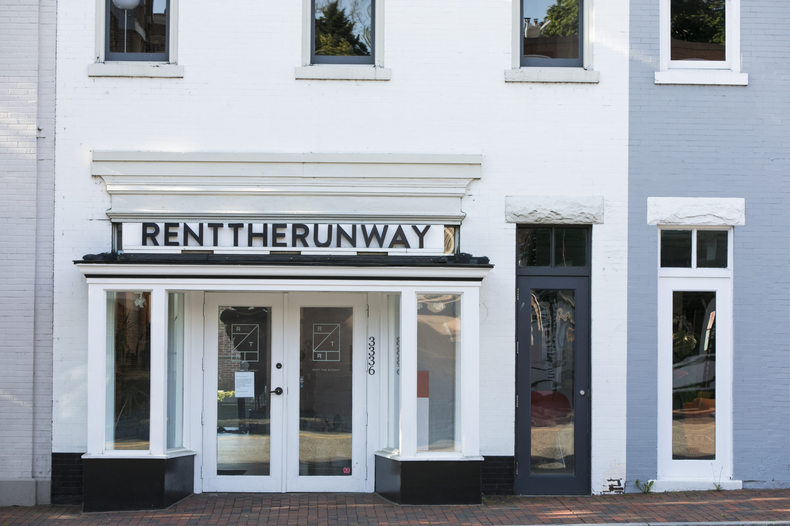 A logo sign outside of a Rent the Runway retail store location in Washington, D.C.