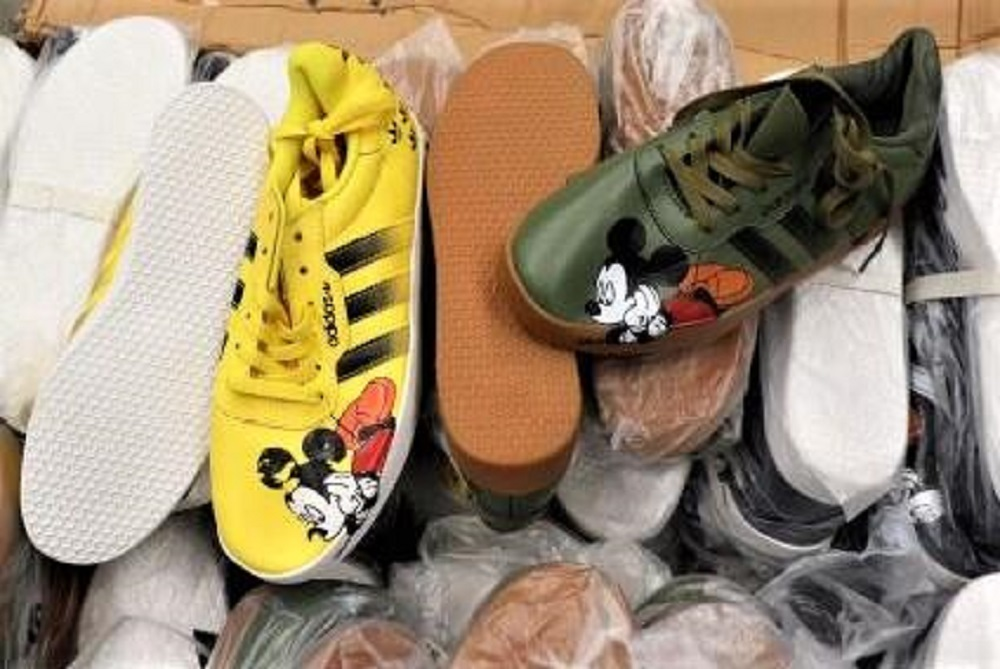 Federal authorities at Los Angeles International Airport seized 1,755 pairs of Nike and Adidas counterfeit shoes arriving from Hong Kong.