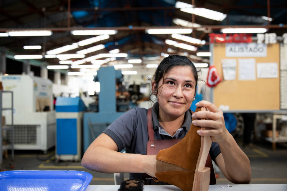 An artisan at Nisolo's factory in Peru working on the brand's Chelsea boot.