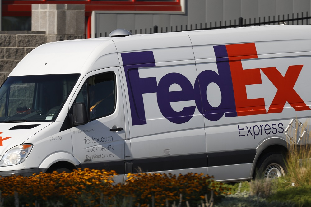 Logistics players like FedEx and Pitney Bowes are taking steps to deal with an anticipated hectic holiday season for e-commerce delivery.
