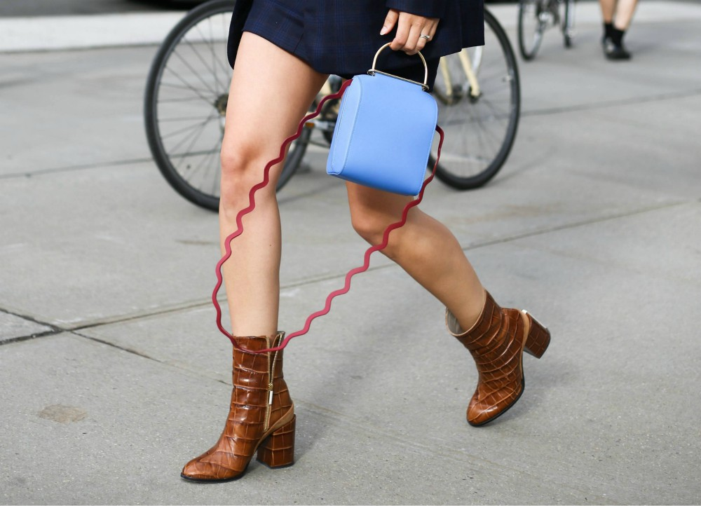 Rebecca Laurey posing in crocodile boots outside of the Dion Lee runway show during New York Fashion Week in 2017. Nordstrom is moving to ban merchandise made with exotic skins.
