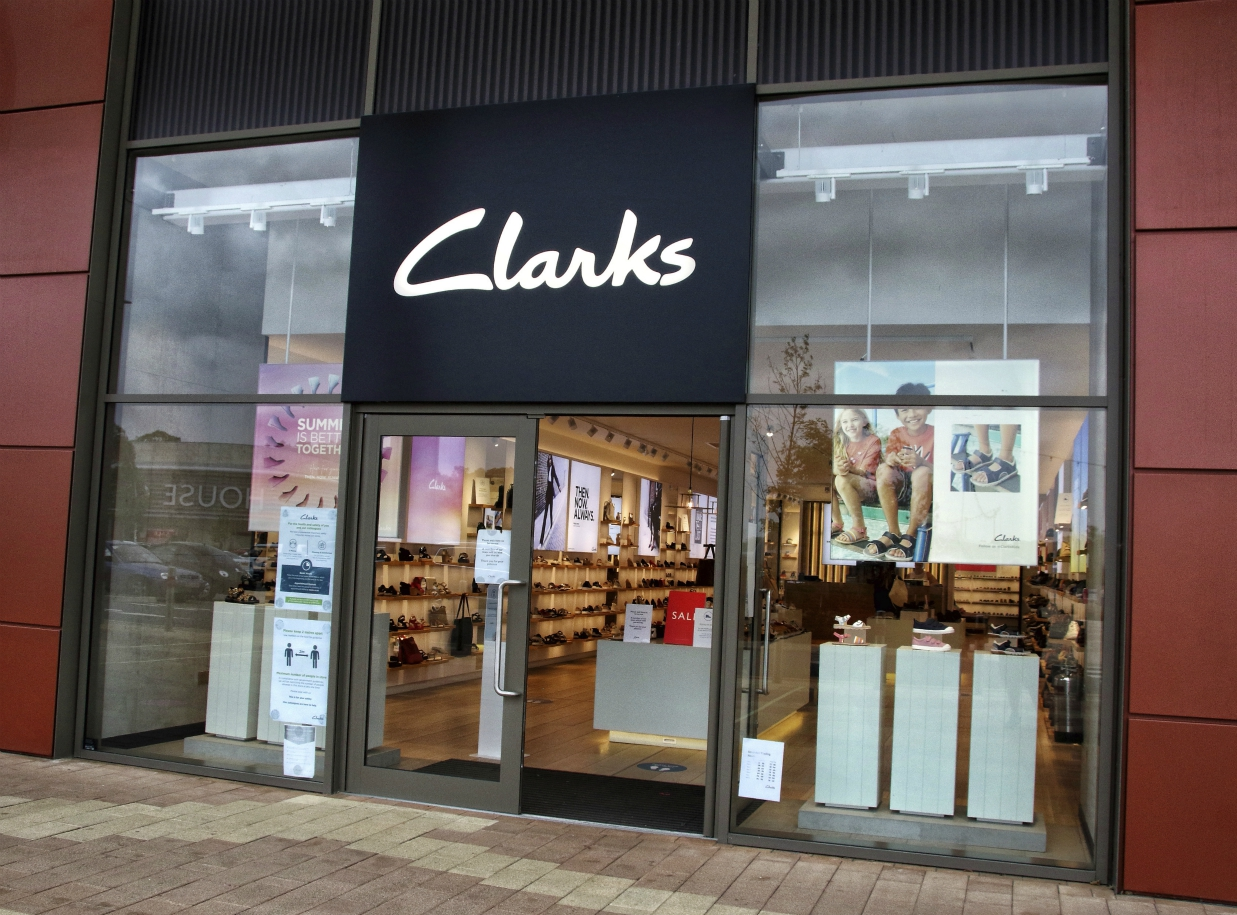 Footwear firm Clarks has a $128.8 million rescue deal with LionRock Capital, but creditor approval would force more store closures.