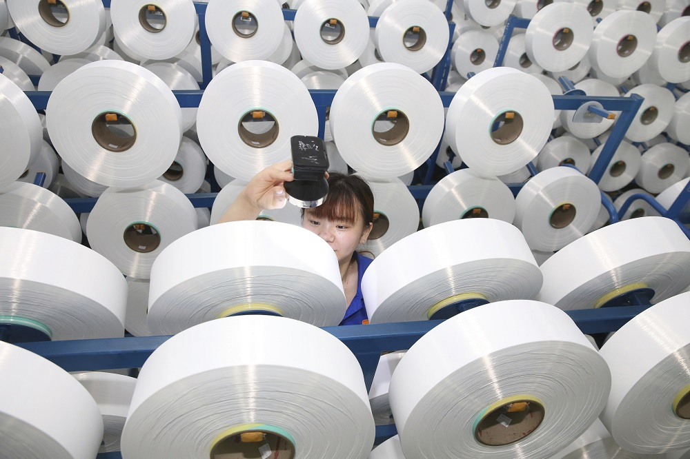 A petition filed by Unifi and Nan Ya Plastics alleges polyester textured yarn from four countries is being dumped on the domestic market.