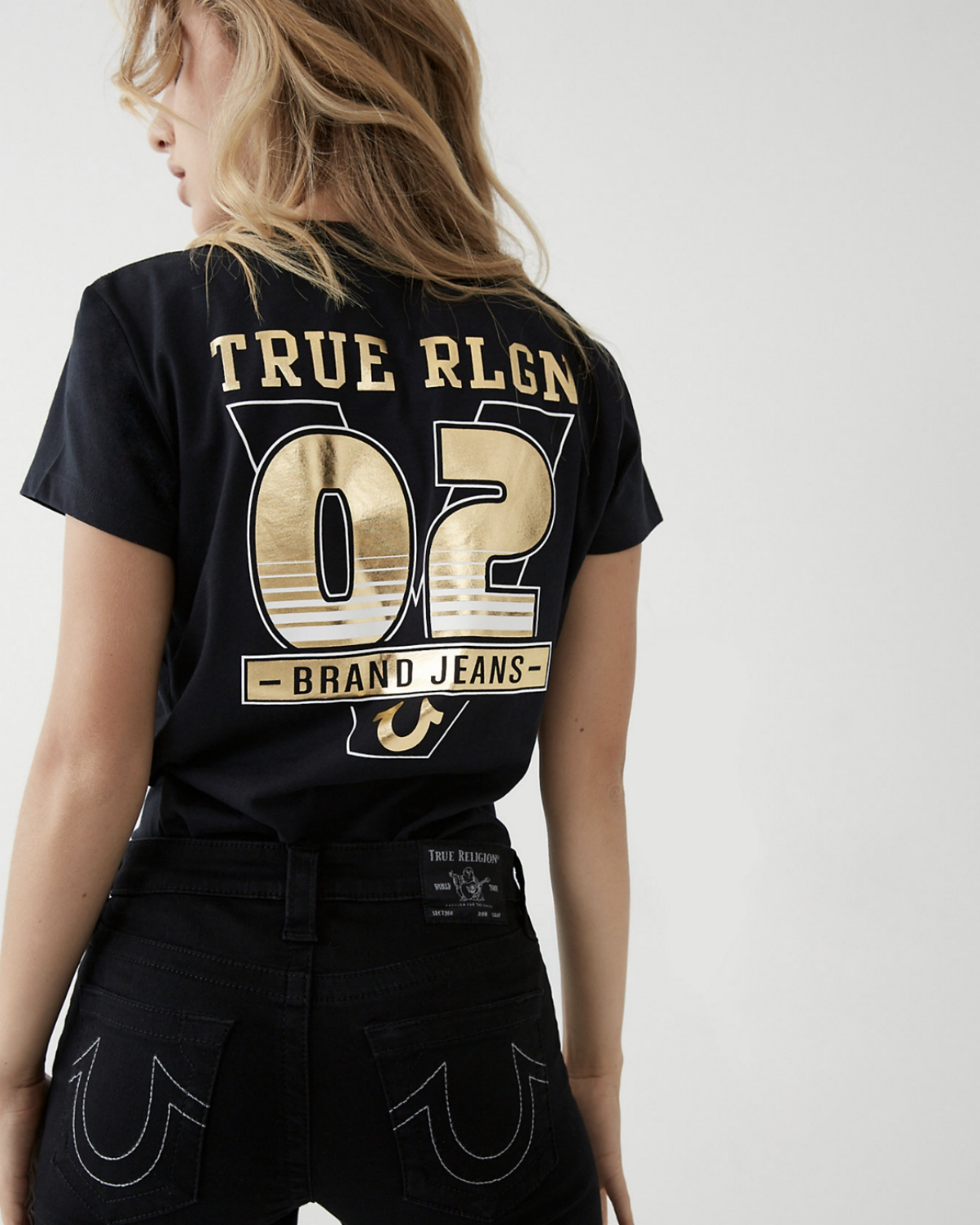 True Religion has resolved a lender dispute, paving the way for the premium denim brand to exit Chapter 11 bankruptcy court proceedings.