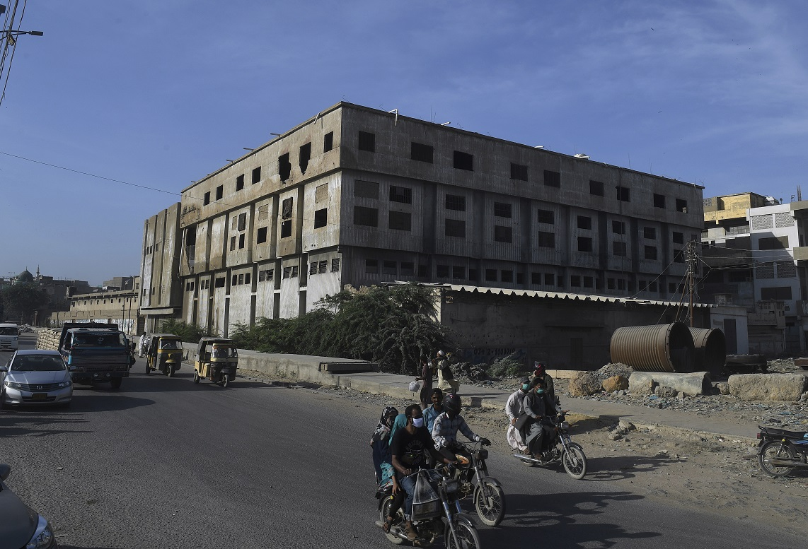 Six laborers at a Pakistan garment warehouse died from suffocation on Saturday while cleaning a chemical tank, highlighting safety issues.