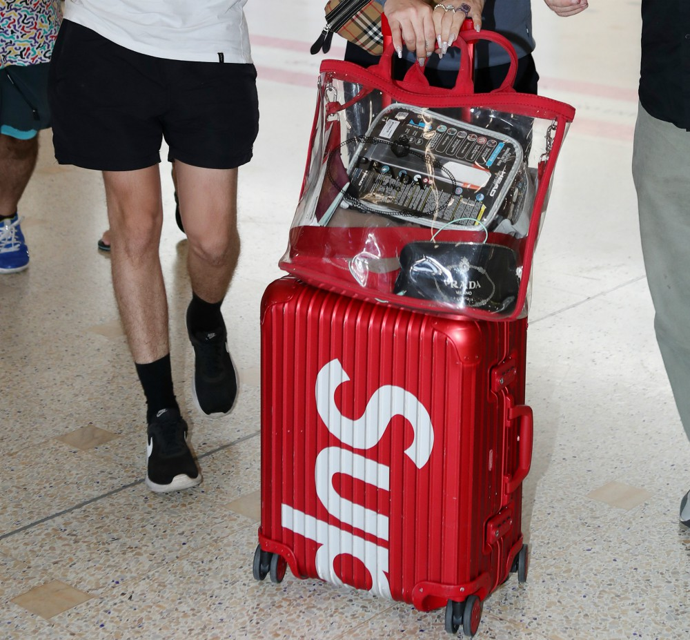 Lily Allen pictured arriving in Sydney sporting Supreme luggage. VF snapped up the streetwear label for $2.1 billion.