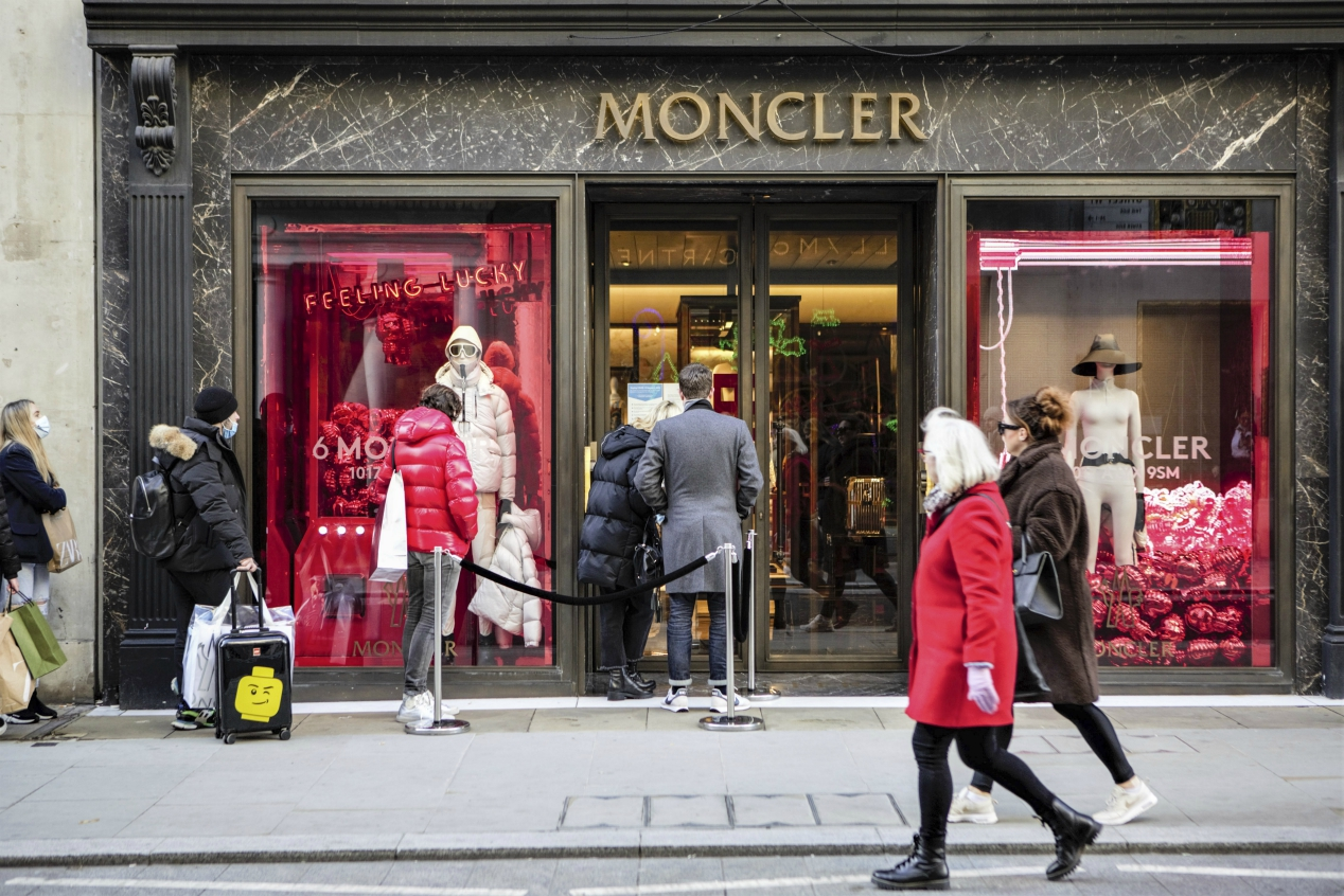 Moncler said it will acquire 70% of the parent of rival Stone Island for $1.4 billion, a move that will help it attract younger consumers.
