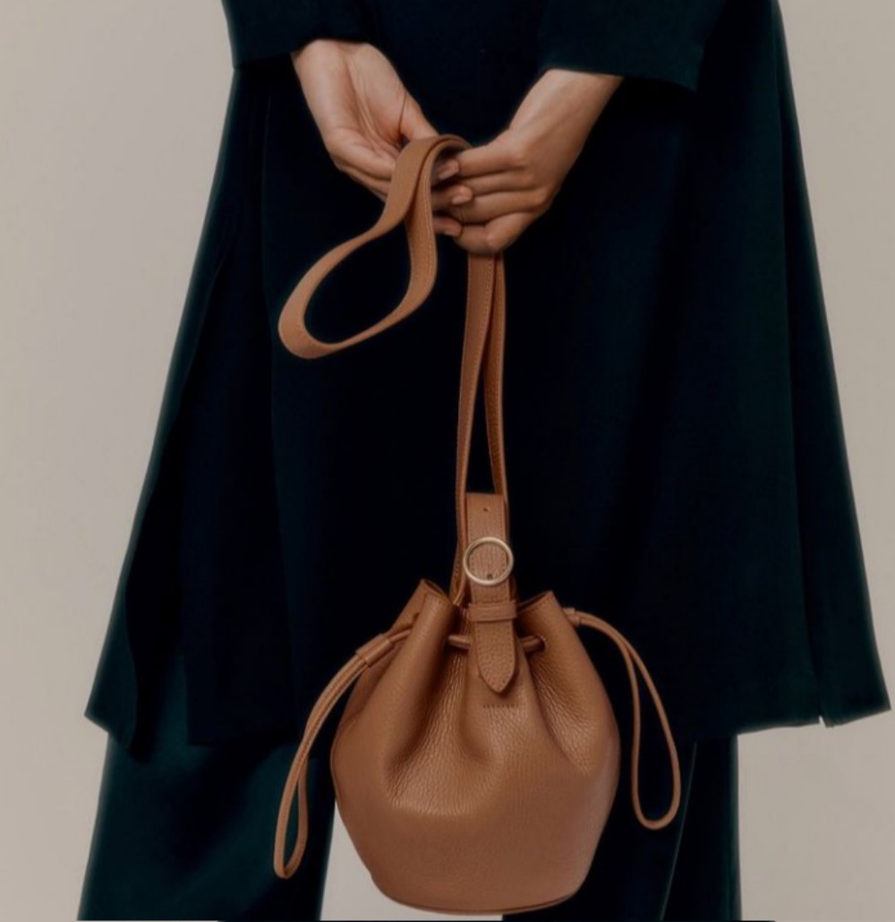 Cuyana's smaller leather goods, like its mini drawstring bucket bag, performed better than its work-ready totes throughout the pandemic.