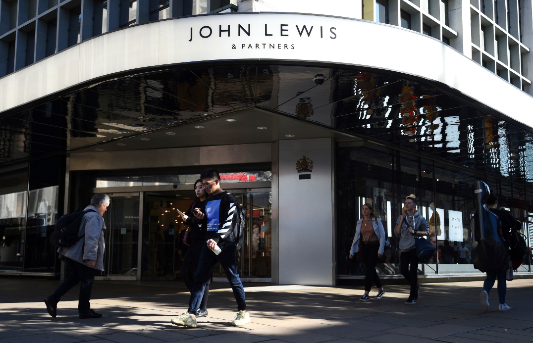 Retailer John Lewis repaid a coronavirus loan early after seeing better-than-expected holiday sales and is also raising full-year guidance.