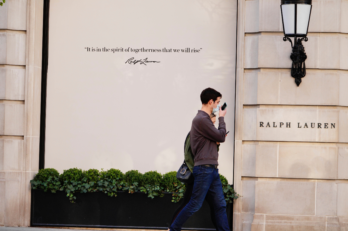 Ralph Lauren shares spiked Friday on unconfirmed speculation that French luxury titan Kering is mulling a takeover of the American clothier.