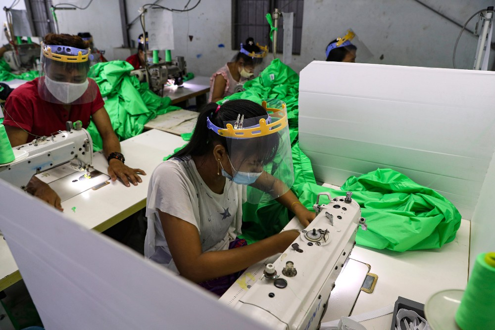Garment workers in Laos and Thailand are being repaid for lost wages after factory owners refused payment and Covid-19 drove down business.
