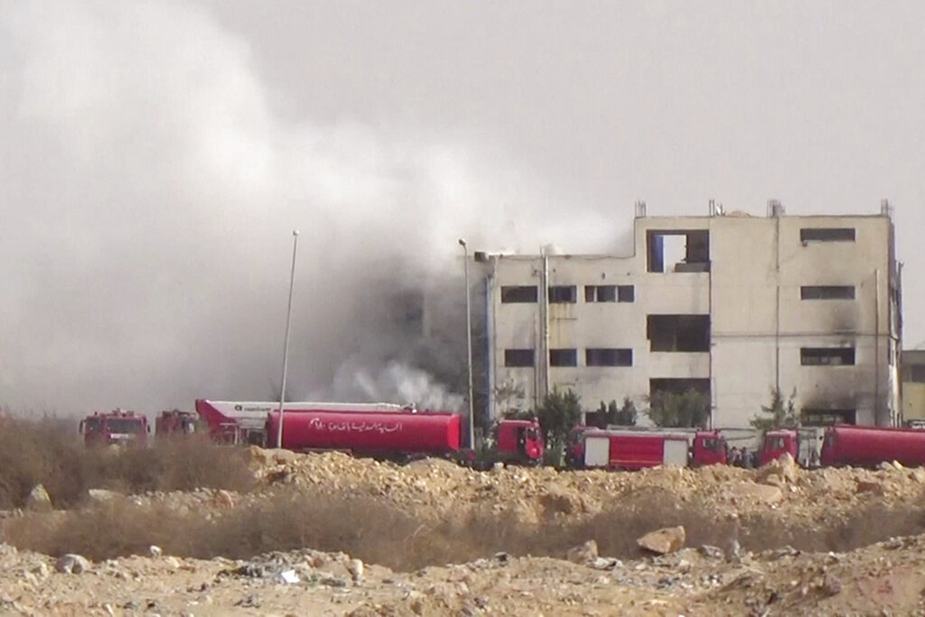 At least 20 workers were killed and 24 injured in Egypt Thursday after a fire ravaged a four-story garment factory north of Cairo.