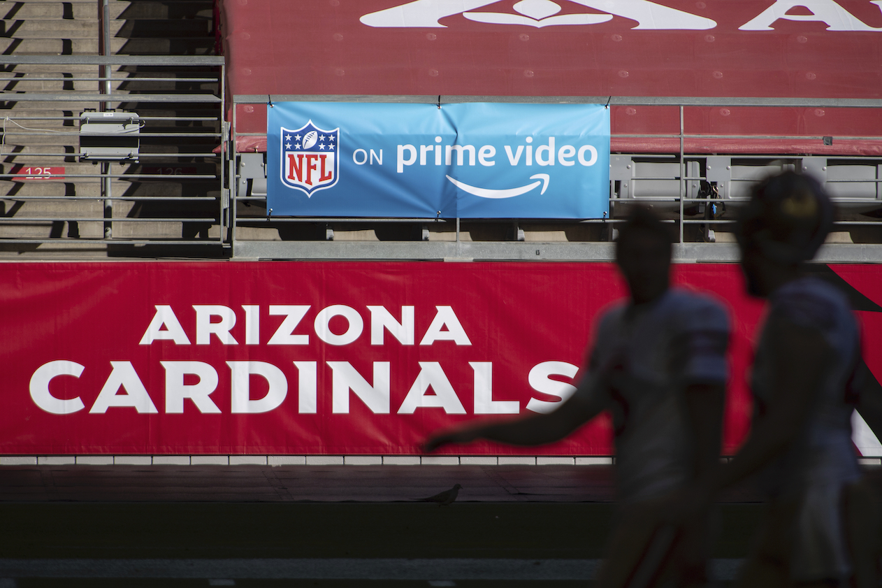 As Amazon expands its partnership with the NFL to sell more licensed gear, Fanatics will open a NFL Shop on the e-commerce giant.