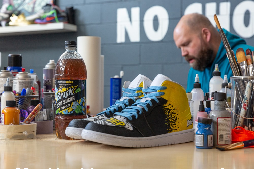 "Five pairs of custom sneakers hand painted by Dan ""Mache"" Gamache will be distributed to the grand prize winners of Brisk's ""Unlock Your Zero Drop."""