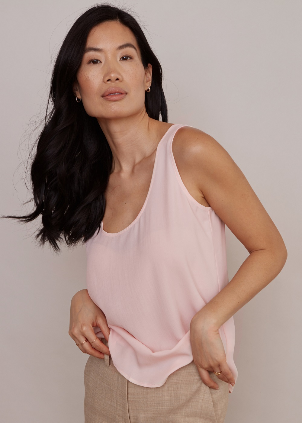 Elevated women's basics brand Numi launched a Sustainable Silk line, including a button-up, short-sleeve blouse, tank top and classic cami.