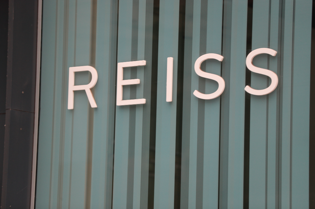 British retailer Next plc to acquire a 25% stake in rival Reiss Ltd., and has an option through July 2022 to add another 26% to its holding.