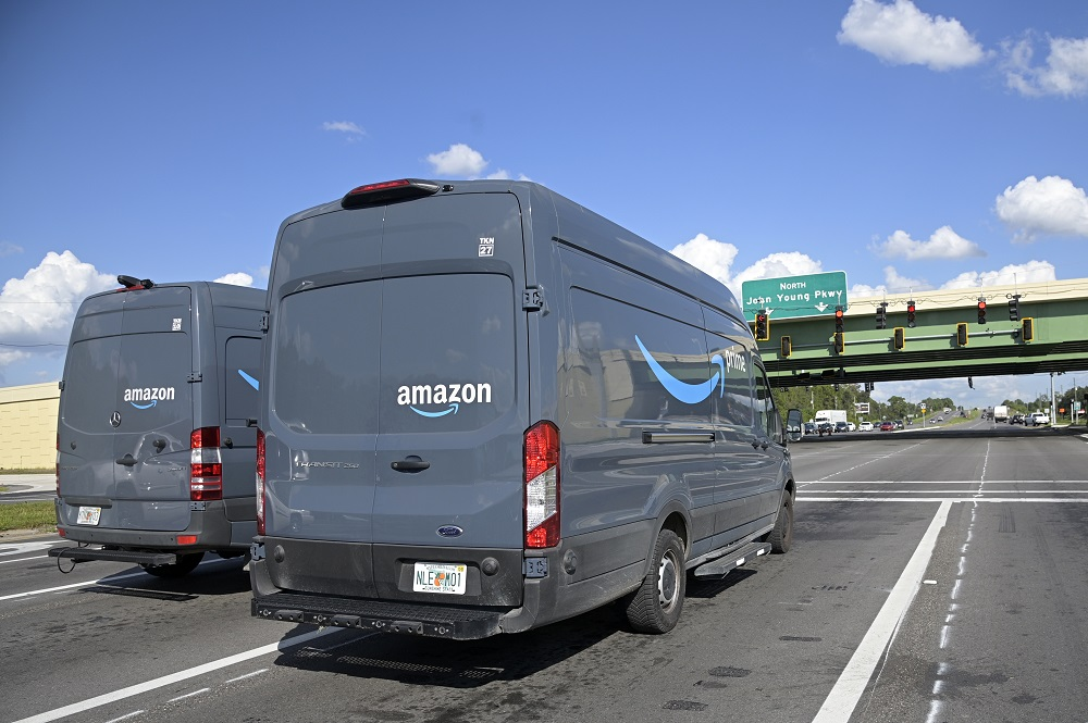 The owner of an automobile transport company was sentenced to 30 months in federal prison for defrauding Amazon of more than $50,000.