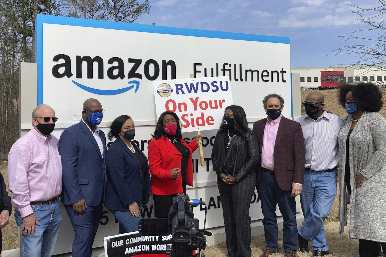 Democratic members of Congress join representatives of the Retail, Wholesale and Department Store Union gather outside an Amazon fulfillment center in Bessemer, Ala., on March 5, 2021, to advocate for the ongoing unionization vote at the sprawling campus. The elected officials pictured include, starting second from left, Rep. Jamaal Bowman of New York, Nikema Williams of Georgia, Terri Sewell of Alabama, Cori Bush of Missouri and Andy Levin of Michigan.