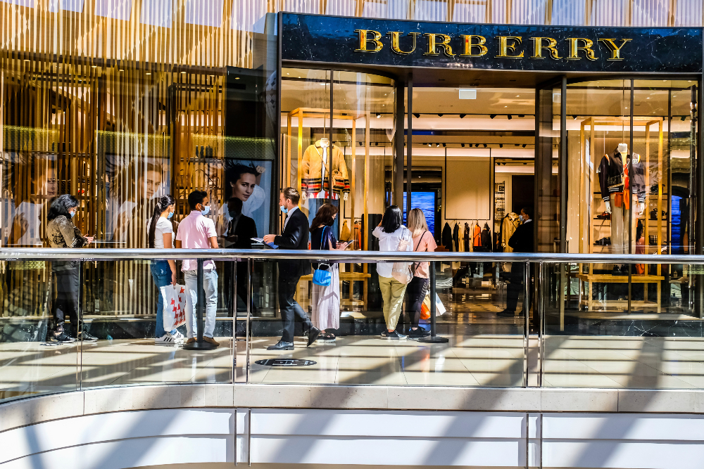 Burberry sees signs of recovery and JD Sports Fashion will take a 60 percent stake in MIG, which operates in nine countries across Europe.