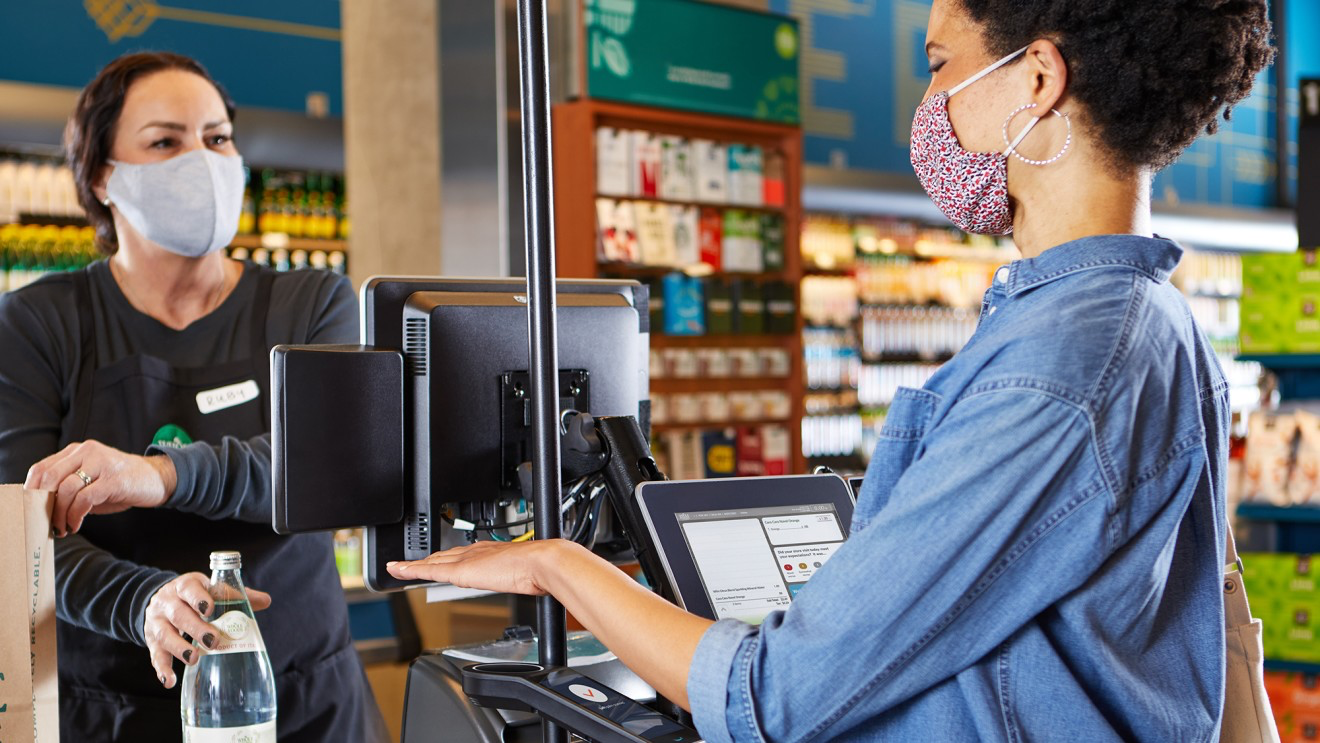 """Amazon is bringing its contactless biometric """"Amazon One"""" technology to eight Whole Foods Market stores in Seattle, enabling more shoppers to pay with their palm instead of swiping or tapping a credit card."""