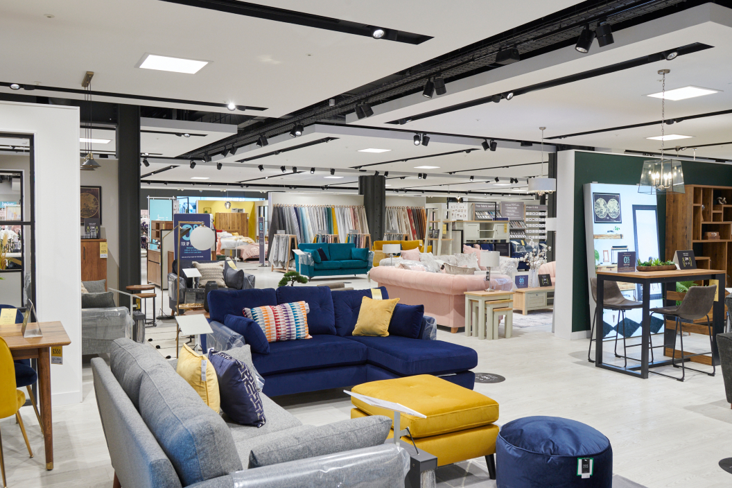 CEO Lord Simon Adam Wolfson explains what he means when he says the British fashion and home chain 'follows the money' in retail.