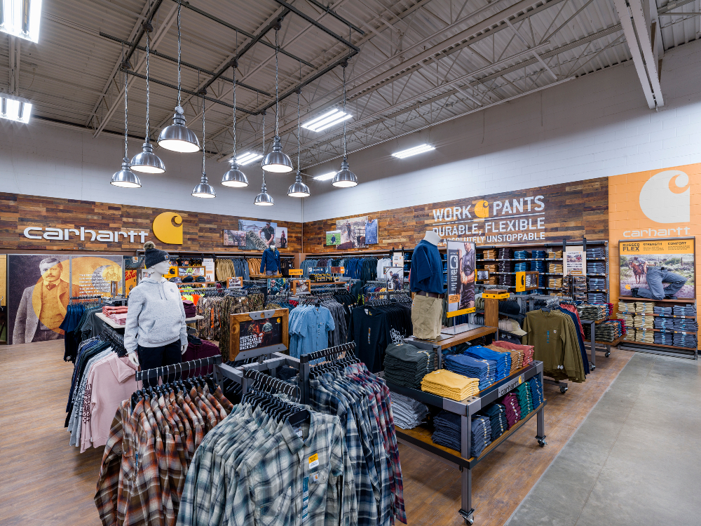 After 10 successful pilots, workwear maker Carhartt is adding 100 shop-in-shops to Tractor Supply stores this year, with 25 slated for 2021.