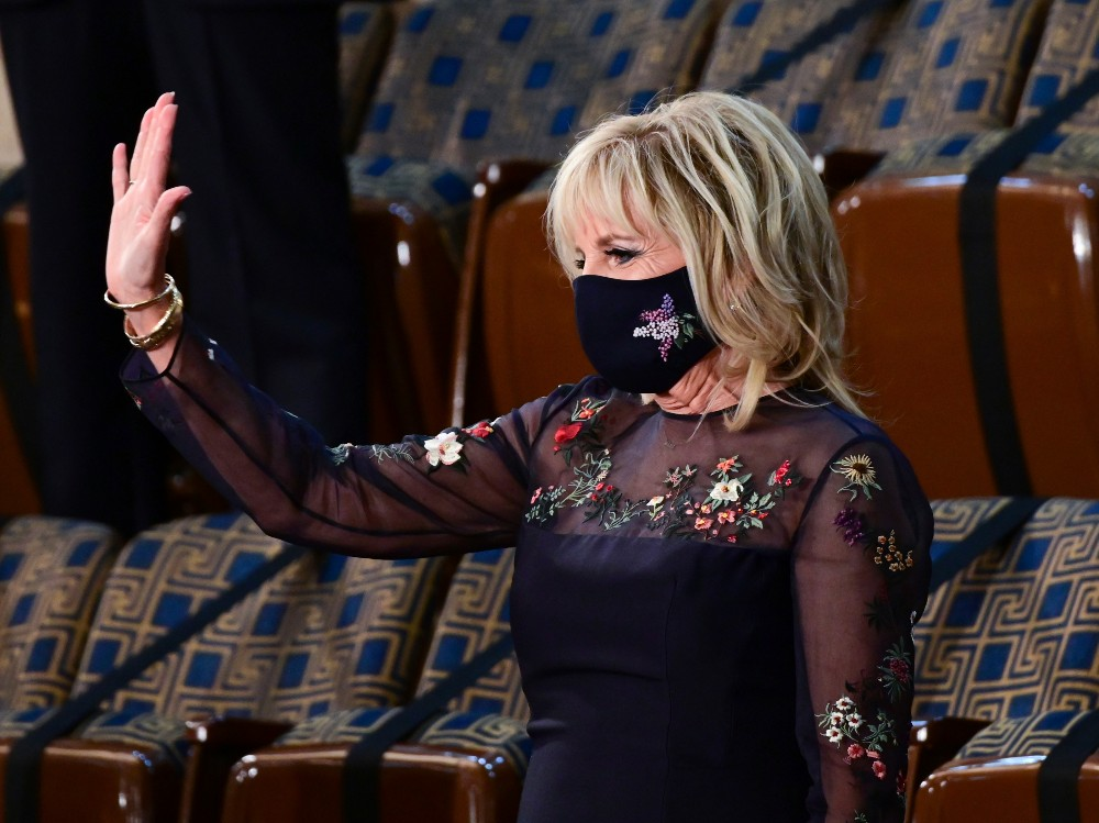 As President Biden addressed a joint session of Congress, First Lady Dr. Jill Biden sported an upcycled Gabriela Hearst luxury dress.