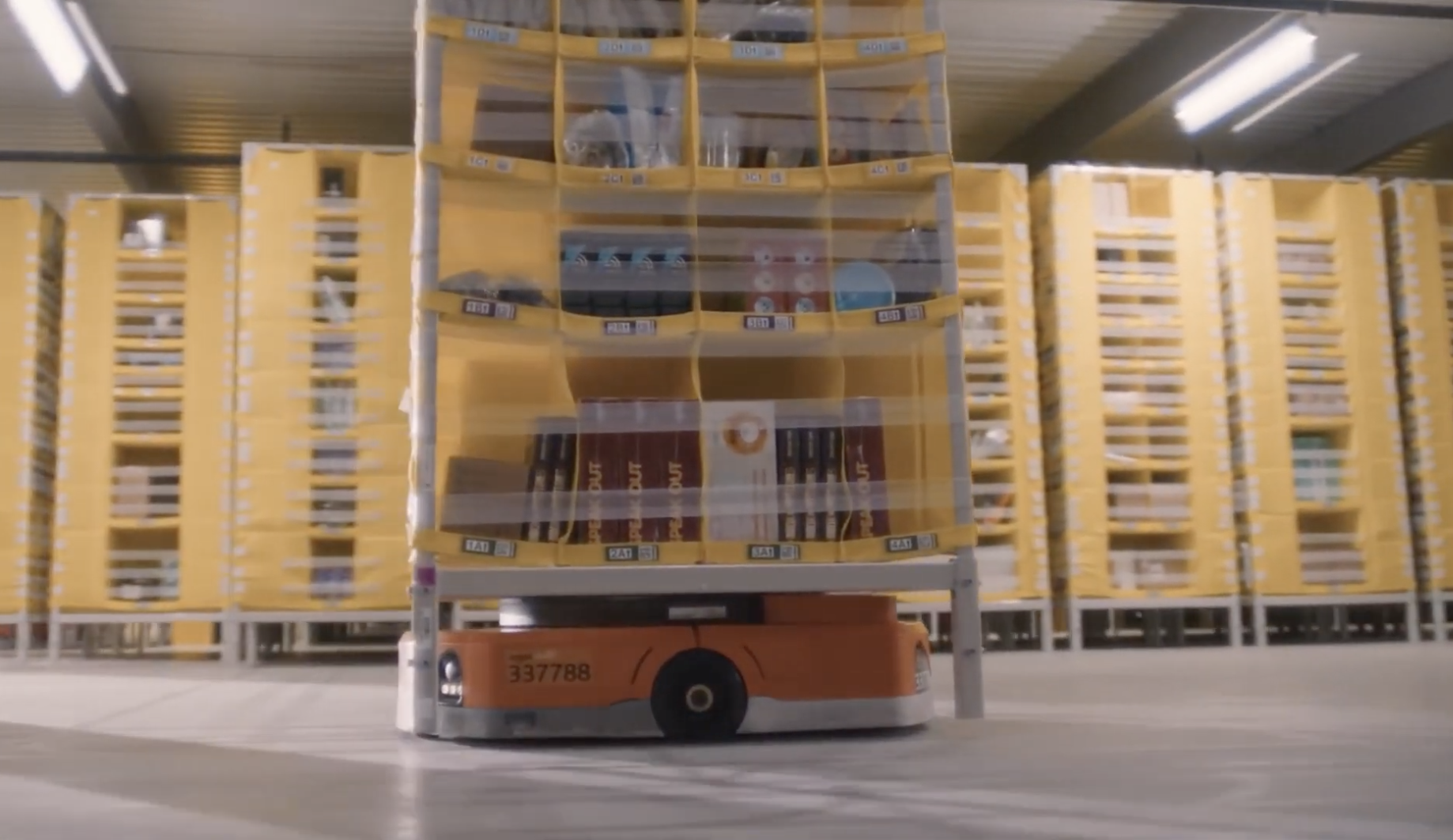 At Amazon robotics fulfillment centers, orange-colored robotic drive units can navigate around the warehouse, lift pods filled with customer orders off the ground and carry them where needed.