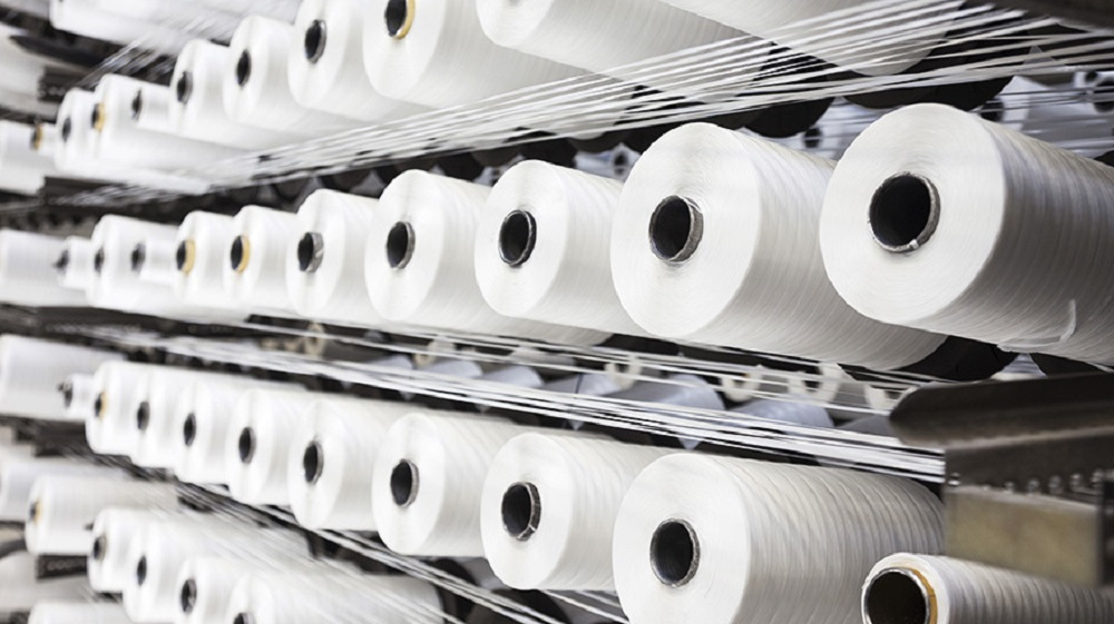 The Commerce Department said imports of polyester textured yarn from four Asian countries were illegally dumped on the U.S. market.