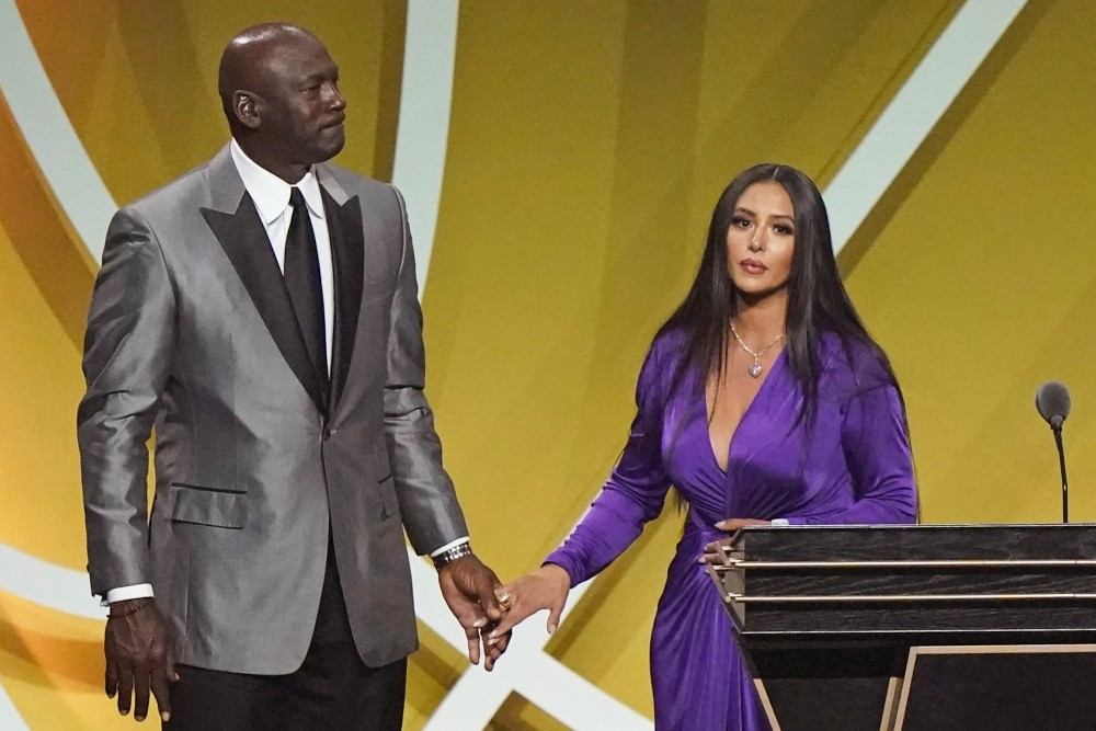 Vanessa Bryant holds Michael Jordan's hand after speaking on behalf of her late husband at his induction into the Basketball Hall of Fame.