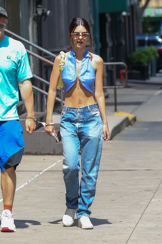 Emily Ratajkowski stepping out in a Prada denim bra top likely helped drive interest in the brand's organic denim top