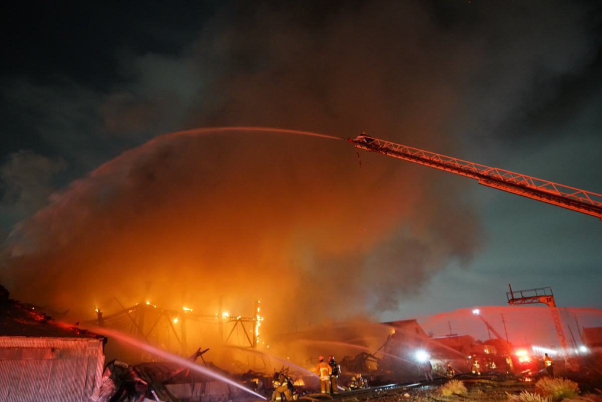 The Los Angeles County Fire Department battled a conflagration at a facility described as a shoe factory and as a warehouse on Salt Lake Avenue that caused the building's roof to collapse.