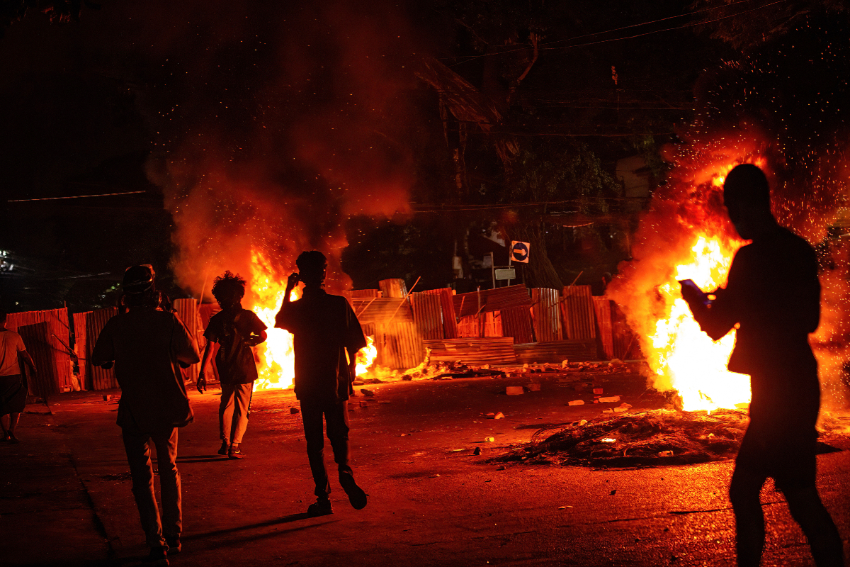 A Myanmar military tribunal has sentenced 34 people to 20 years in jail with hard labor for arson attacks on garment factories in March.
