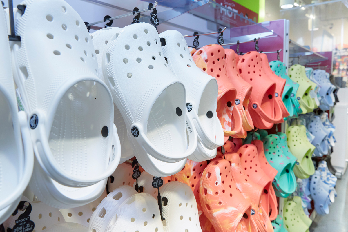 Crocs, the king of the foam clog, announced it filed 21 lawsuits in courts across the country, taking aim at brands both big and small that allegedly violated its protected and registered marks