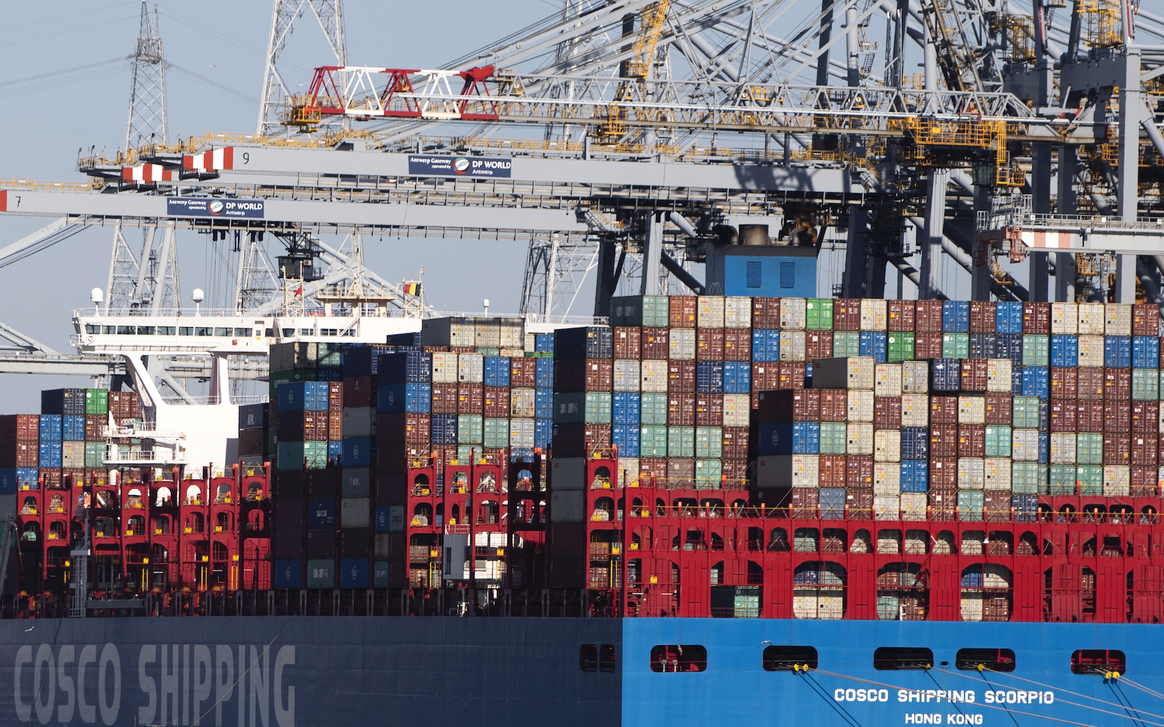 Shipping containers are offloaded from a vessel in the Port of Antwerp, Belgium.