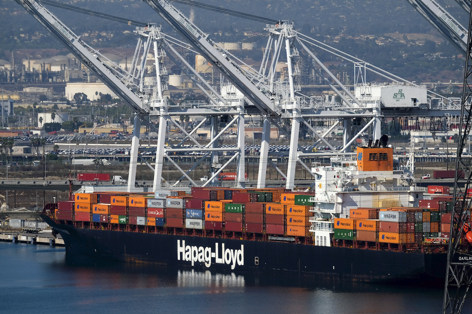 A Hapag-Lloyd container ship is seen docked at the Port of Long Beach, Calif., Friday, Oct. 2, 2020.