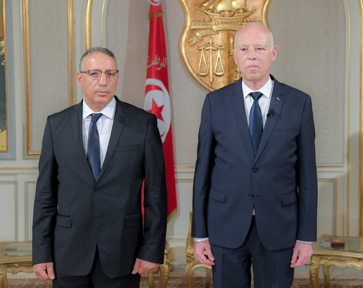 New acting Tunisian Interior Minister Ridha Gharsallaoui, left, and Tunisian President Kais Saied poses after a sworn in ceremony at the Presidential Palace in Carthage, outside Tunis, Tunisia, Thursday, July 29, 2021. Tunisian President Kais Saied on Thursday appointed Ridha Gharsallaoui, a former national security adviser to the presidency, to run the Interior Ministry.