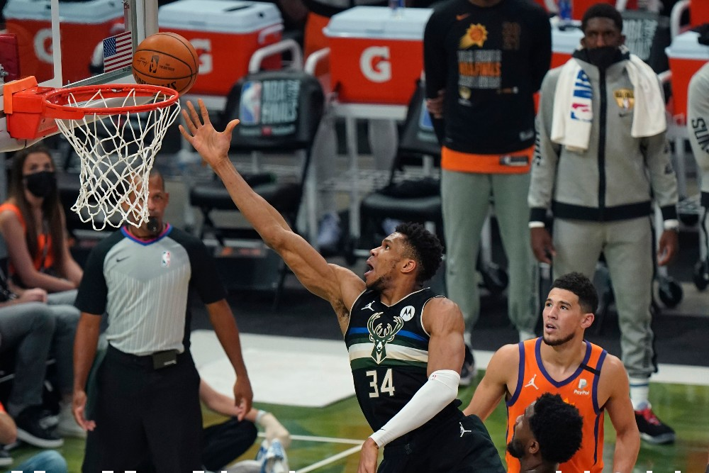 NBA Finals rivals Giannis Antetokounmpo (left) and Devin Booker (right), both two of the top scorers in the NBA Playoffs, both wear Nike shoes.