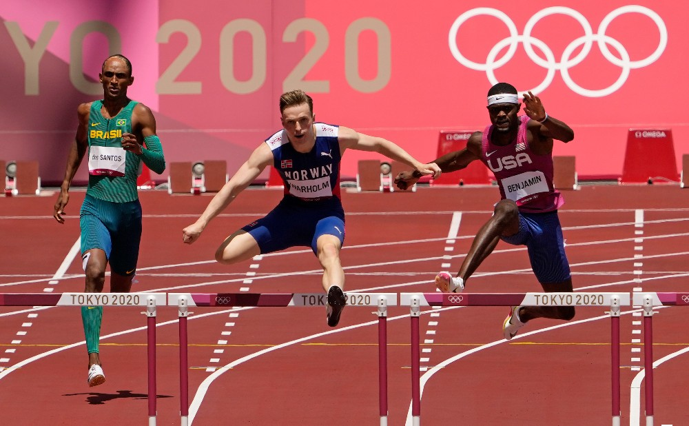 Karsten Warholm [center] broke the world record in the 400-meter hurdles, with Alison Dos Santos [left] and Rai Benjamin [right] finishing behind him in third and second, respectively. All three finished ahead of the world record Kevin Young set 29 years ago and that had stood until this July.