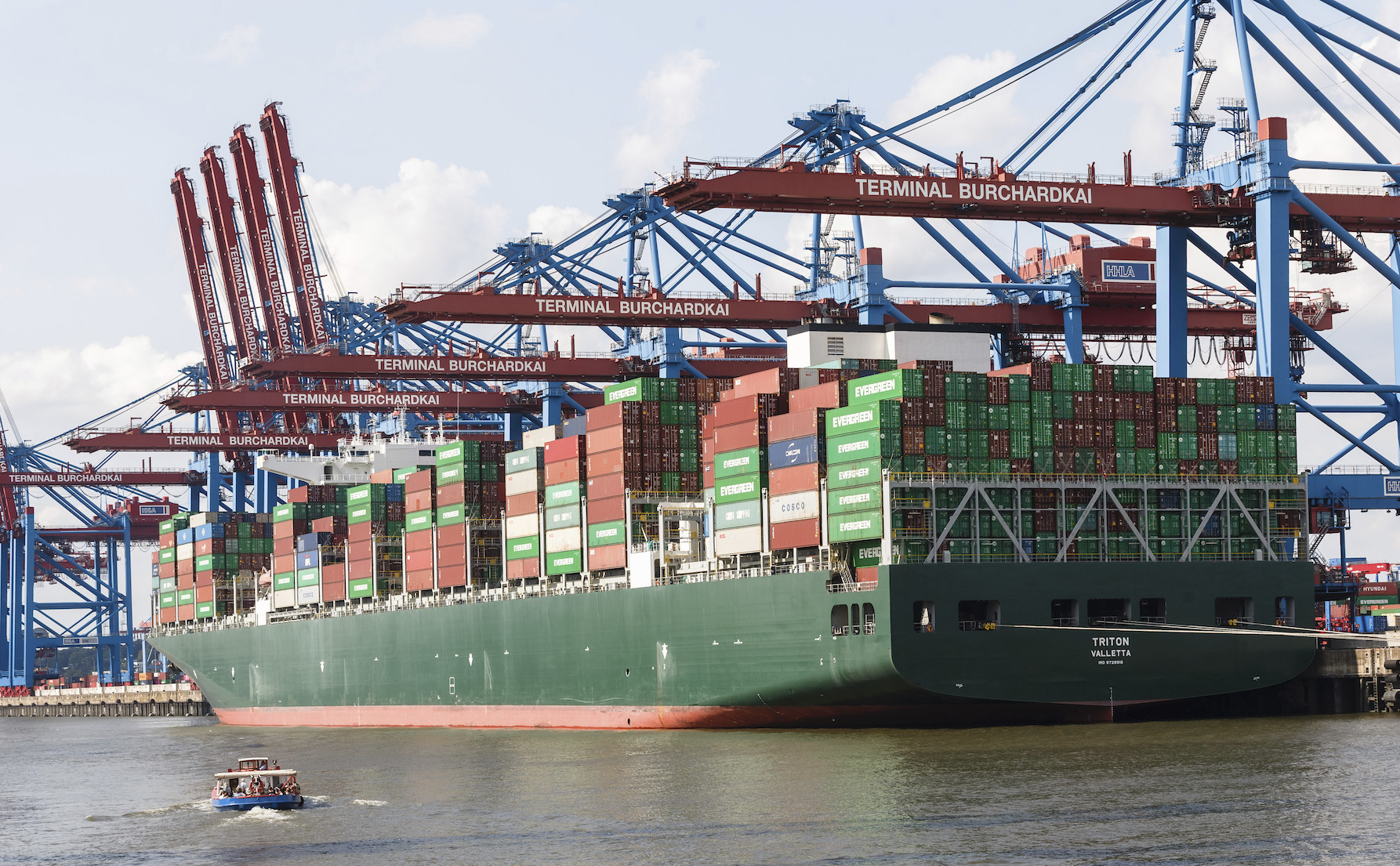 12 August 2021, Port of Hamburg: A container ship is moored at Burchardkai.
