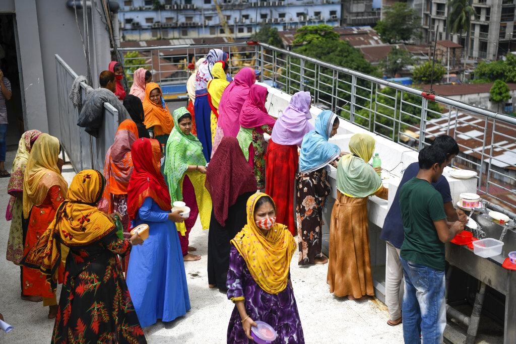 Garment workers taking precautions in Dhaka, Bangladesh - 17 Aug 2021