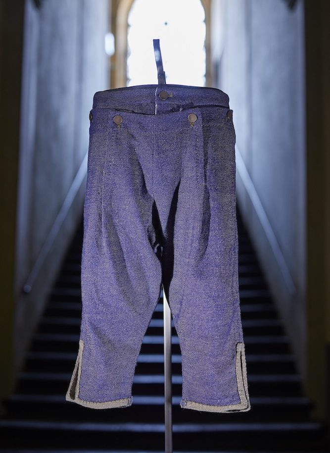 Diesel showcased a reproduction of the oldest documented jeans fabric, featuring denim trousers modeled after an historic nativity figurine.