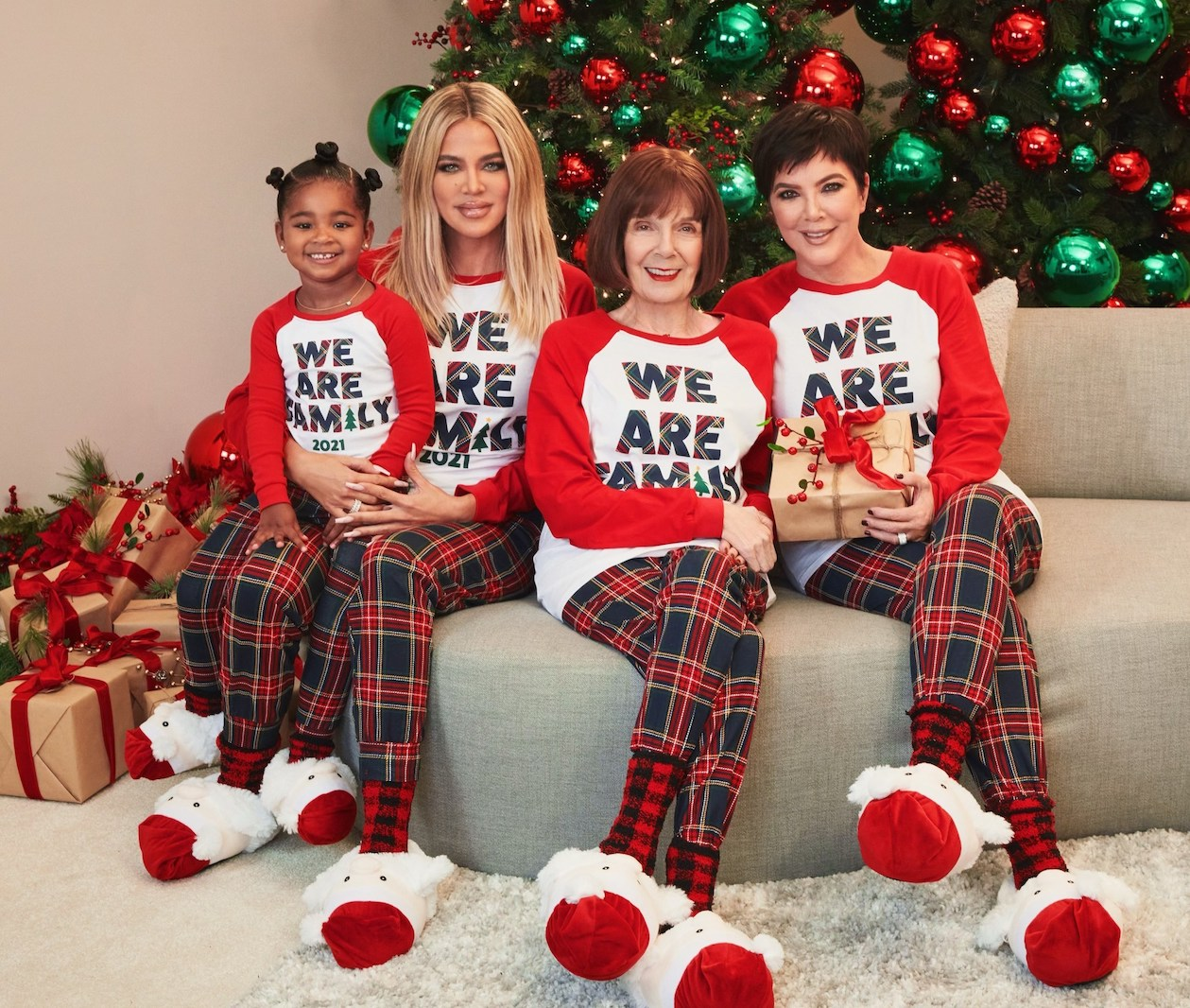 Khloé Kardashian and her daughter, True, and Kris Jenner and her mom, MJ Shannon wear The Children's Place 2021 Holiday Matching Family Pajamas.