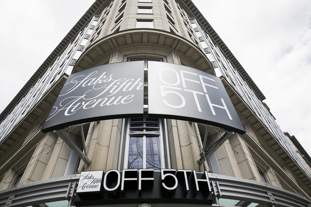 Luxury off-price retailer Saks Off 5th said it is raising minimum base wages for hourly store associates in North America to $15 per hour.
